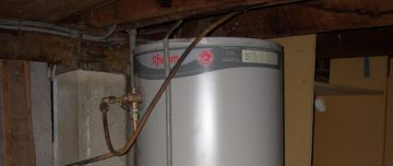 Photo of Rheem hot water system under house