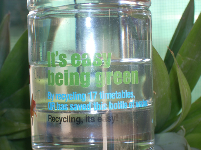 QR It's Easy Being Green bottled water. By recycling 17 timetables QR has saved this bottle of water. Recycling, it's easy!