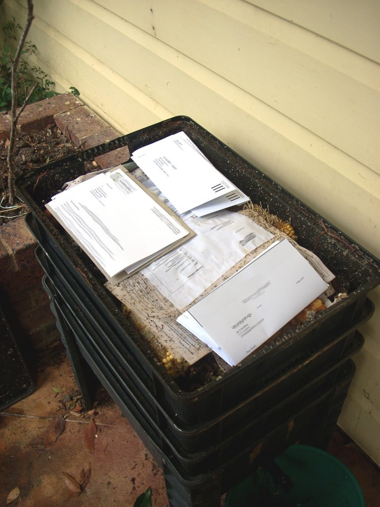 Stuart's worm farm with envelopes and letters for document destruction