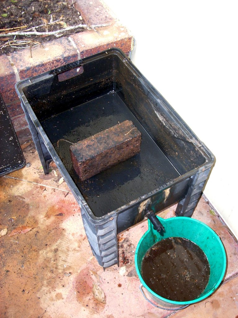 Stuart's worm farm with brick in bottom tray