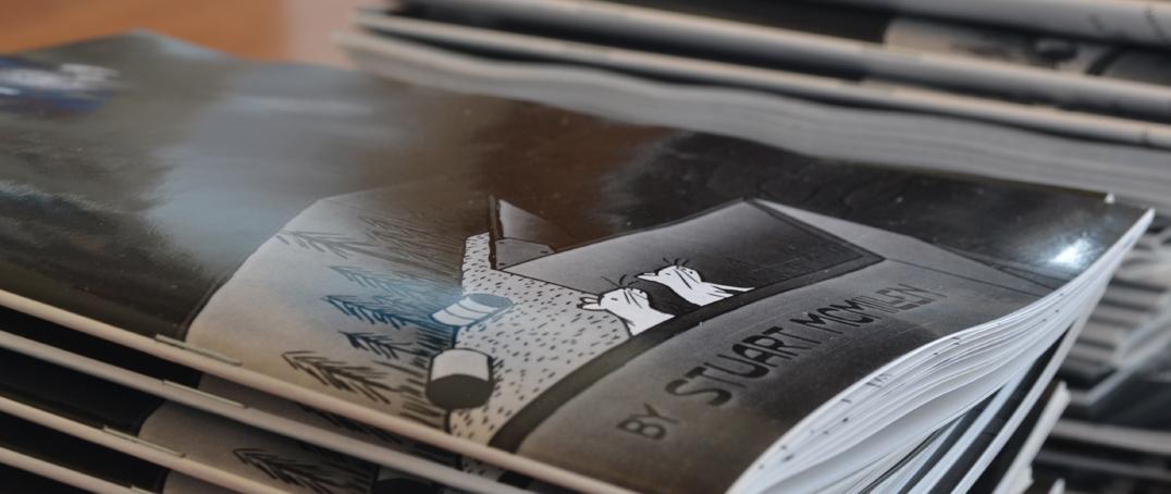 Closeup of glossy comic covers