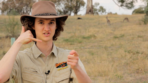 Stuart McMillen as Macca with Akubra hat and khaki shirt during Aussie crowdfunding video