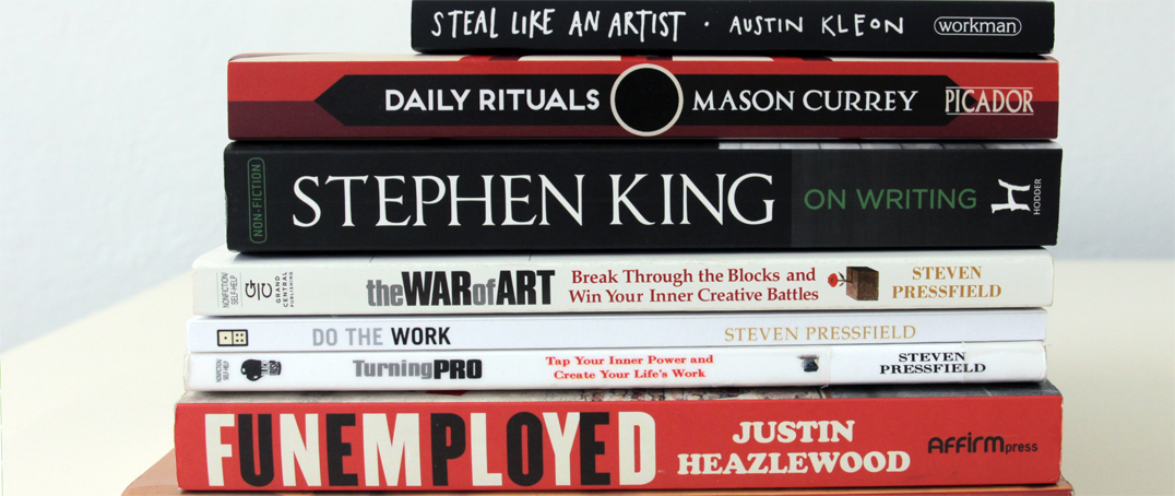 Pile of books about the challenges of artists and freelancers