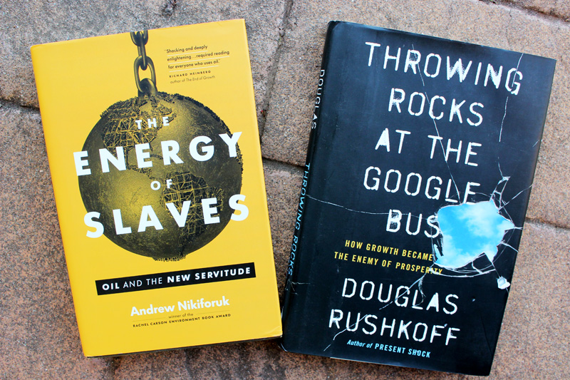 """Book covers: """"The Energy of Slaves"""" by Andrew Nikiforuk, and """"Throwing Rocks at the Google Bus"""" by Douglas Rushkoff"""