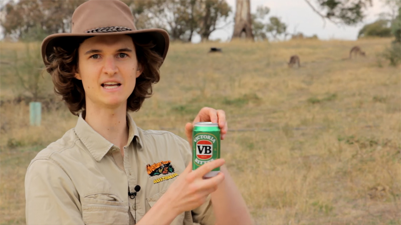 Stuart McMillen holding a can of VB beer