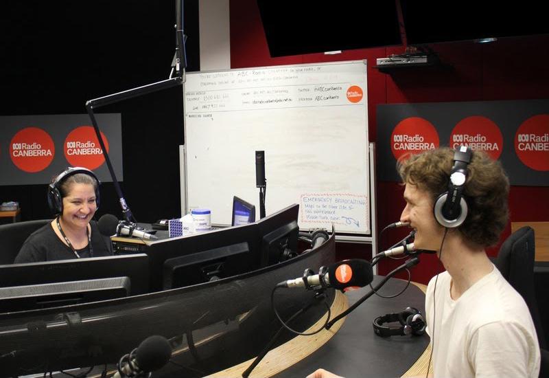 Stuart McMillen interviewed in radio studio.