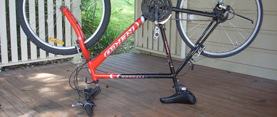 Upside-down bicycle on verandah