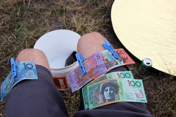 Money pegged to shorts during Stuart McMillen's Aussie crowdfunding video shoot
