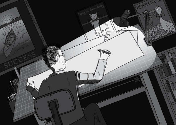 Man working in a darkened office under a desk lamp on an architect's table. View over the shoulder of a man writing on paper laid on a drawing board beneath a desk lamp. Successories motivational posters hung on the wall in an office.