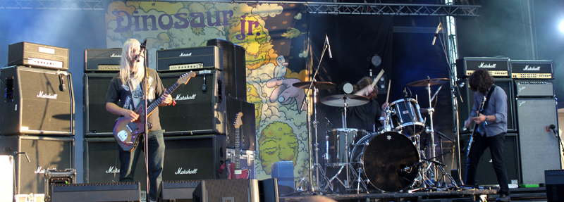 Dinosaur Jr. performing live at a festival outdoors
