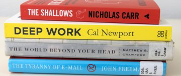 Pile of books about concentration, productivity, and distraction