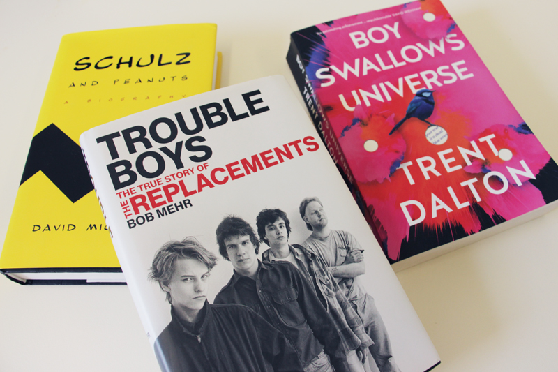 "Book covers: ""Schulz and Peanuts"" by David Michaelis, ""Trouble Boys"" by Bob Mehr, and ""Boy Swallows Universe"" by Trent Dalton"