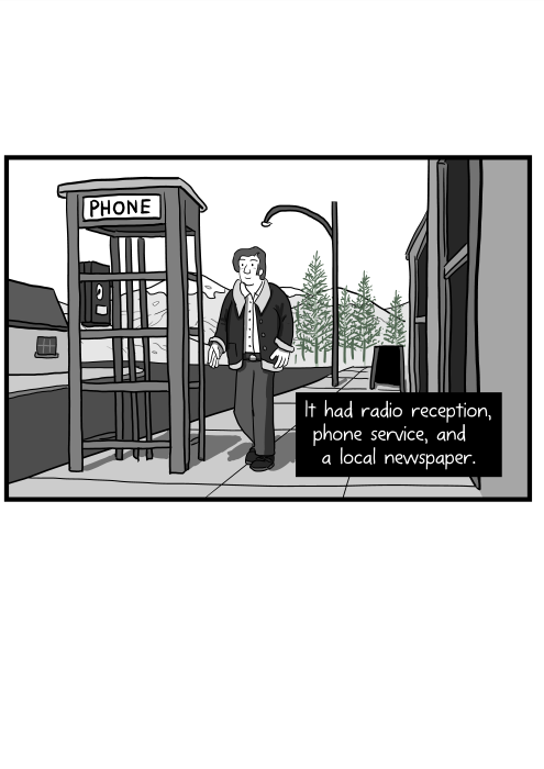 It had radio reception, phone service, and a local newspaper. Cartoon of man walking along a street near a phone booth in small town.