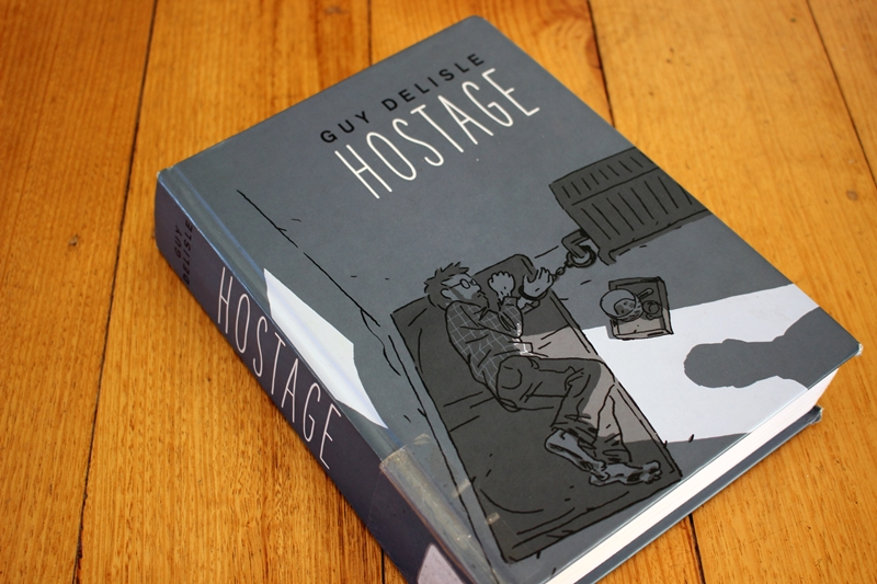 Guy Delisle - Hostage - book cover on table