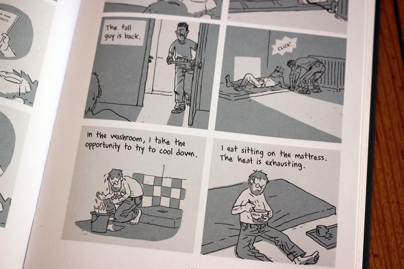 Pages from 'Hostage' by Guy Delisle - p185 - the tall guy is back, washroom